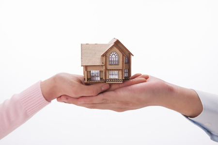 A shot of Hand holding house model photo