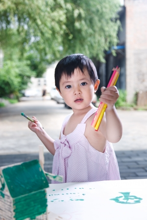 A shot of Little girl painting photo