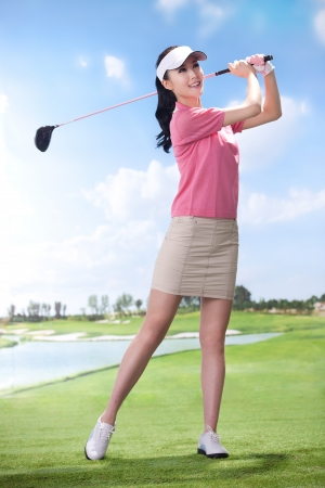A shot of Young woman playing golf
