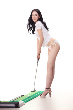 A shot of Sexy woman holding golf clubs photo
