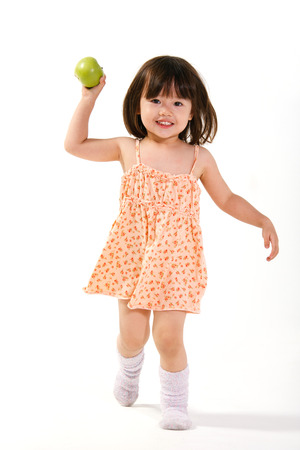 A shot of Girl holding apples photo