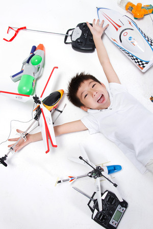 A shot of Boy lying with toys photo