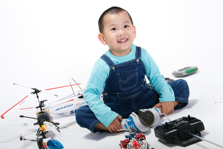 A shot of Boy with toys photo