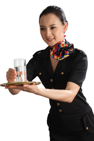 flight attendant: A shot of Chinese flight attendant holding cup of water