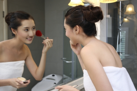 A shot of Young woman making-up in bathroom Stock Photo - 24656842