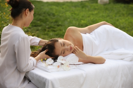 A shot of Young woman having massage Stock Photo - 24695836
