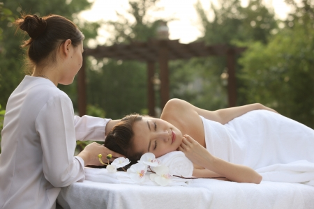 A shot of Young woman getting massage from masseuse