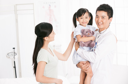 chinese ethnicity: doctor and girl with her mother Stock Photo
