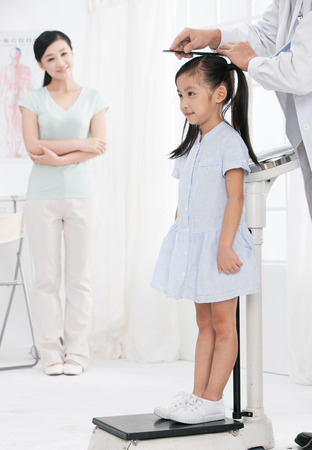 doctor and girl with her mother Stock Photo