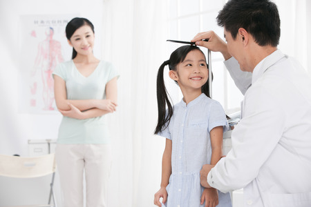 doctor examining woman: doctor measurement the girl stature