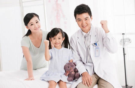 doctor and girl with her mother Stock Photo - 30132201