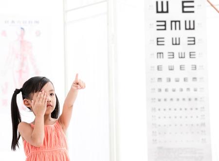 girl testing her eyes