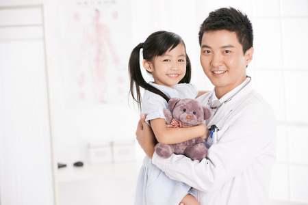 east asian ethnicity: doctor and girl Stock Photo
