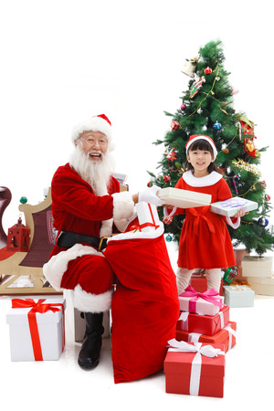 65 69 years: Happy Santa Claus and little girl in Christmas Stock Photo