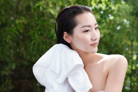 chinese courtyard: Young woman bathing Stock Photo