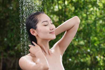 young women only: Young woman bathing Stock Photo