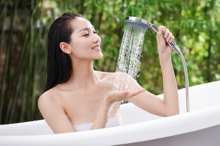 Young woman bathing Stock Photo