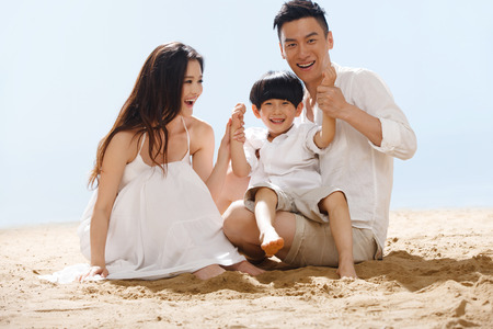 asian men: Family on beach
