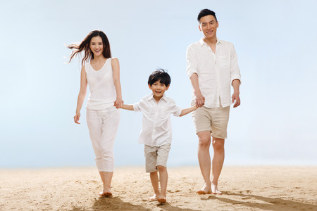 Family on beach Stock Photo - 34917202