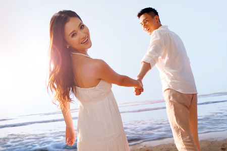 Couple on beach Stock Photo