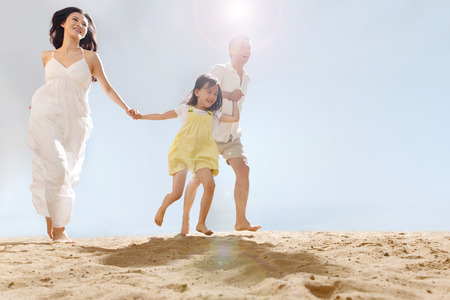 young asian couple: Family on beach