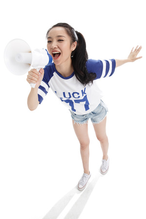 high angle shot: The young woman holding a microphone shouted