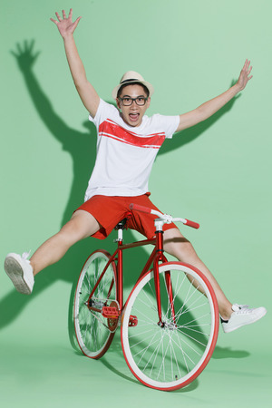 east riding: Young man riding a bicycle