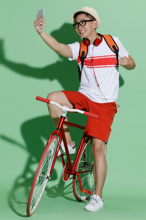 self conceit: Young man riding a bicycle