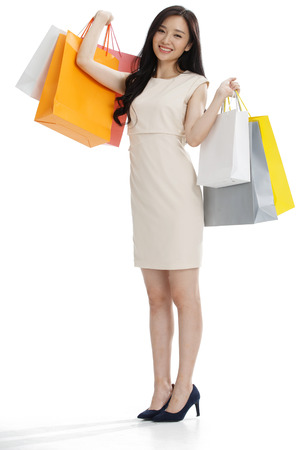 commercial event: The young girl has a shopping bag.