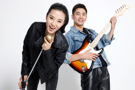 oriental ethnicity: Fashionable young men and women singing