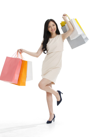 asian businesswoman: The young girl has a shopping bag.