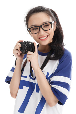 oriental ethnicity: A young woman with a camera Stock Photo