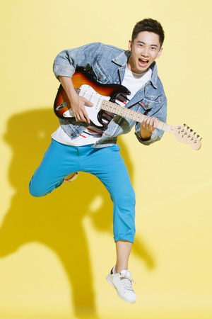 cool guy: Young man playing guitar Stock Photo