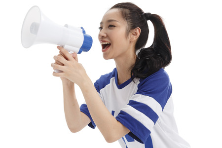 oriental ethnicity: The young woman holding a microphone shouted