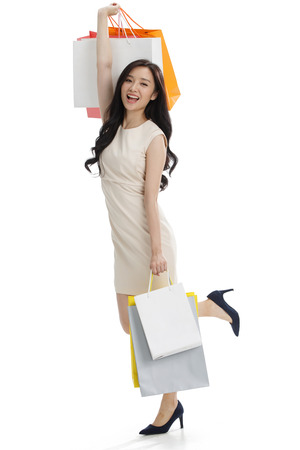 commercial event: A young girl with a shopping bag