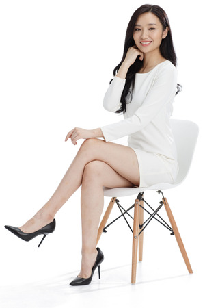 legs crossed at knee: Young business woman Stock Photo