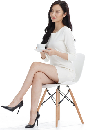 legs crossed at knee: Young women in business