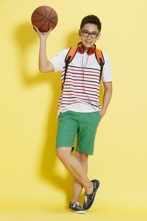 holding aloft: Happy young man Stock Photo
