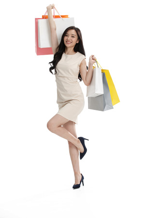 woman bag: The young girl has a shopping bag.