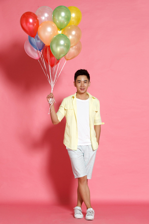 asia people: A young man holding a balloon Stock Photo