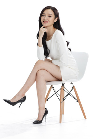 women sitting: Young business woman Stock Photo