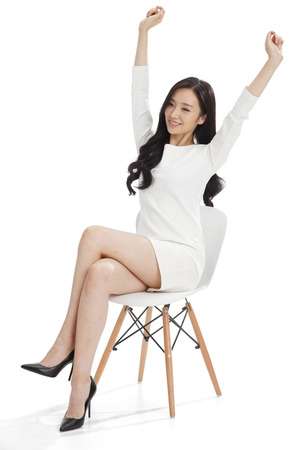 arms on chair: Young business woman Stock Photo