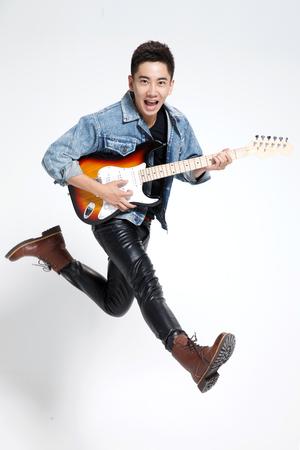 man playing guitar: Young man playing guitar Stock Photo