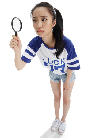 oriental ethnicity: A young girl with a magnifying glass