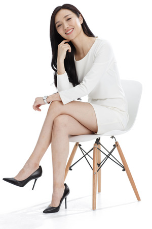 legs crossed on knee: Young business woman Stock Photo