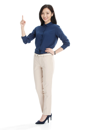 standing up: Young business woman Stock Photo