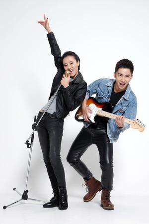 full shot: Fashionable young men and women singing