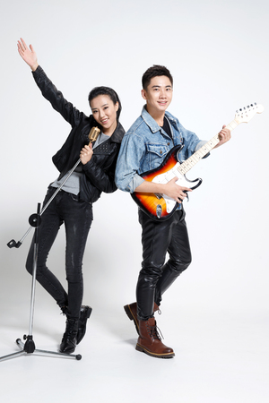 Fashionable young men and women singing