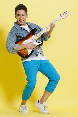 young men: Young man playing guitar Stock Photo