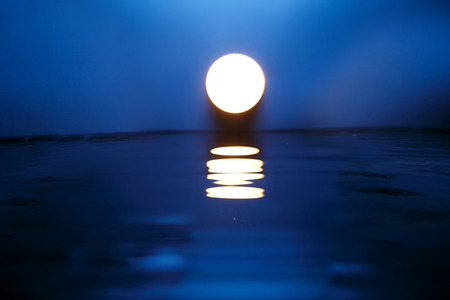 horizon reflection: Full Moon Stock Photo